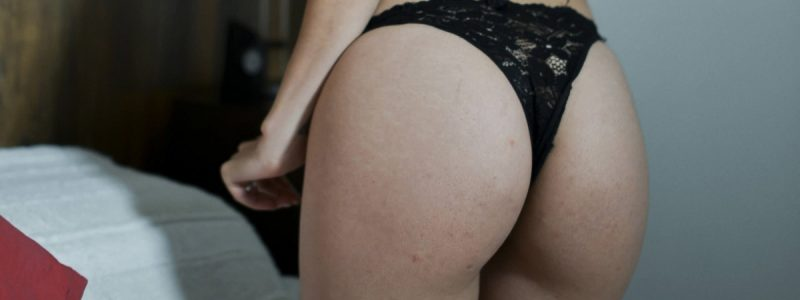 woman showing off bubble butt wearing black lace panties